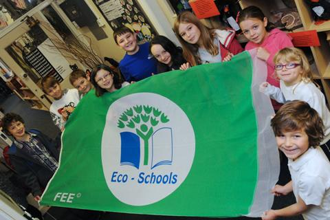Pupils at Goostrey Primary School with their eco-school flag 	Picture: Nick Jones n125020