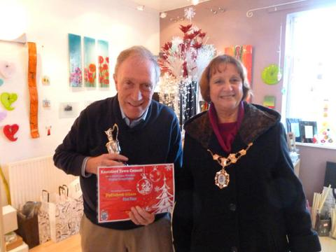 Town Mayor Clr Vivien Davies with John Kulikowski from Polished Glass, which won the best dressed Christmas window award. His wife Maureen owns the King Street shop