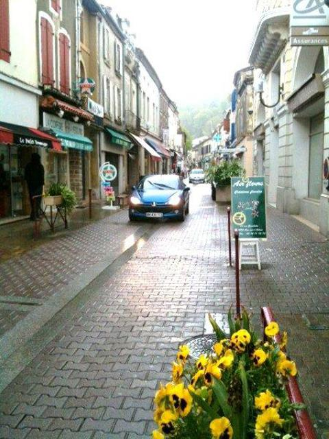 A car drives down the shared space road in south west France