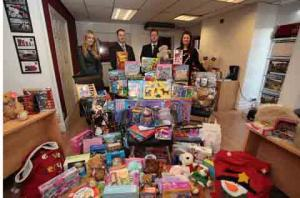Knutsford Guardian: From left, Charlotte Cooper, Mark Hazlehurst, Nick Tomlinson and Nicola Smalley with the mountain of Christmas presents