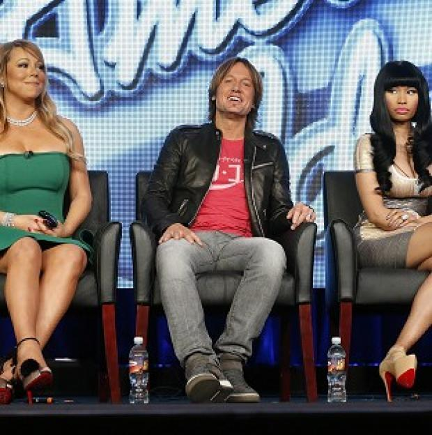 Keith Urban sits between Mariah Carey and Nicki Minaj as they talk about American Idol