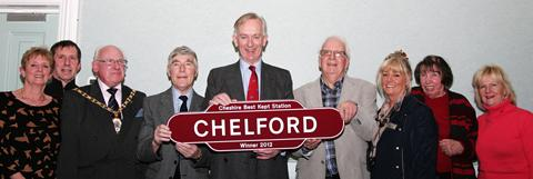 Chelford celebrates its award with David Briggs, Lord Lieutenant of Cheshire, centre