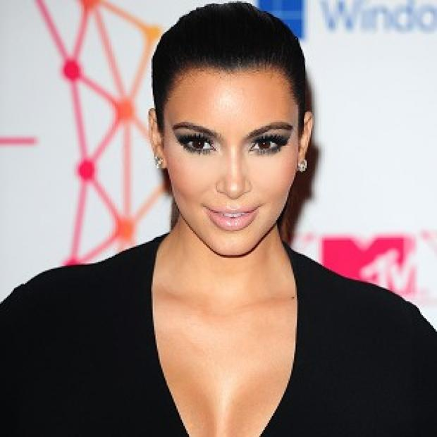 Kim Kardashian has since removed the gun photo from her Twitter page