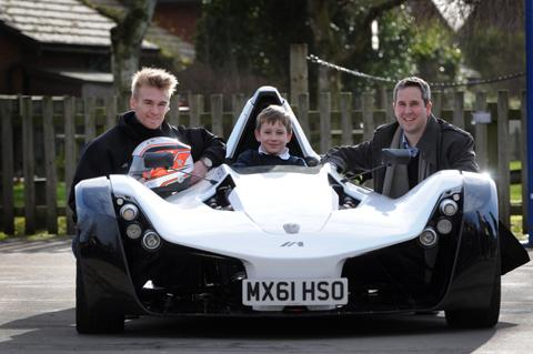 Knutsford racing driver Oli Webb, with Ian Mallon, right, and Nathaniel Mallon, in the driving seat                                                 n130639