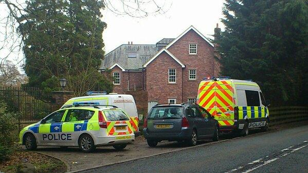 Police vans outside the property on Mereside Road
