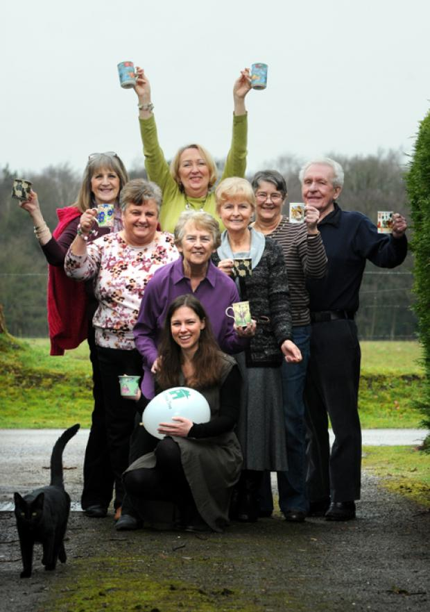 Pictured, left, Dorothy Saxton, back row, centre, celebrates with some of her guests at a coffee morning at her home in Goostrey                                       n130746