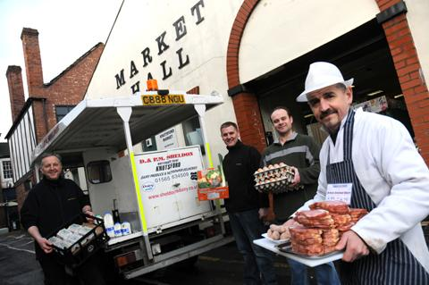 Left, the town's traders have teamed up to offer local produce in a delivery box for Knutsford residents. From left, Steve Edwards, from Sheldons, Alan Bolshaw, Mike Brown and Ian Emmess            n130812