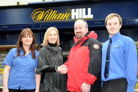 From left, Samantha Wood, deputy manager at William Hill, Sarah Flannery, Dave McClure from Cheshire Search and Rescue and Charlie Griffin, cashier   n130715