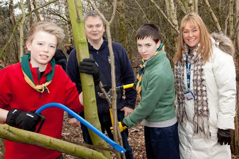 Knutsford Scouts help to create the wild classroom. From left, James Woods, Nick Rowles from Cheshire Wildlife Trust, Edward Lawton and Janet Ward from INEOS ChlorVinyls