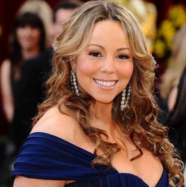 Mariah Carey has shrugged off reports she will be performing at Glastonbury