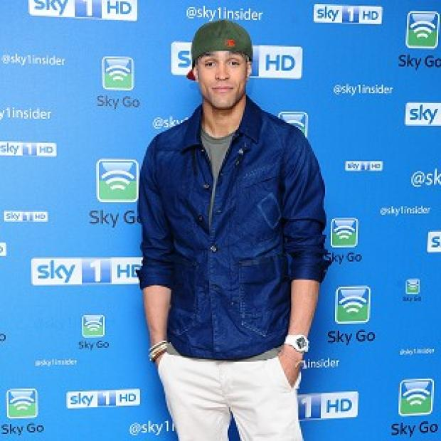 Ashley Banjo wears his hat when he goes swimming