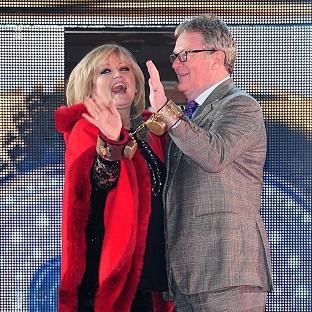 Linda Nolan and Jim Davidson enter the Celebrity Big Brother house while handcuffed together