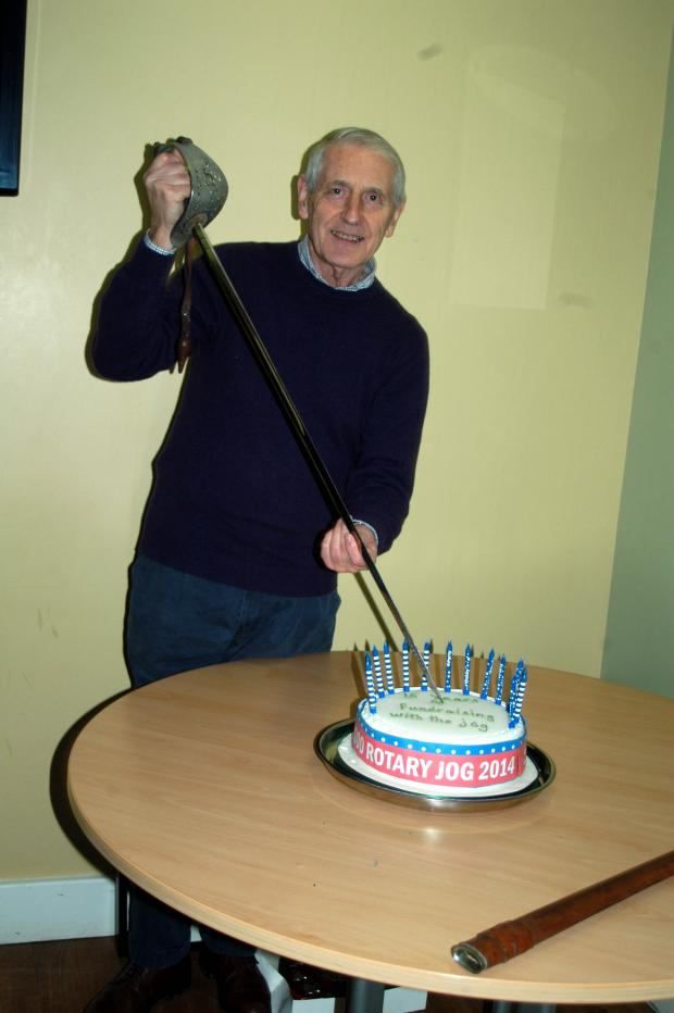 Knutsford Guardian: Rotary president  Alan Ingram cuts  the special cake