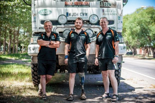 Knutsford Guardian: Race2Recovery race truck crew pose in front of their 2014 Dakar rally race truck - left to right: Chris Ratter from Knutsford, Daniel Whittingham and Mark Callum