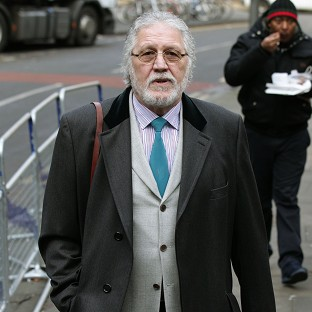 Former DJ Dave Lee Travis arrives at Southwark Crown Court in London