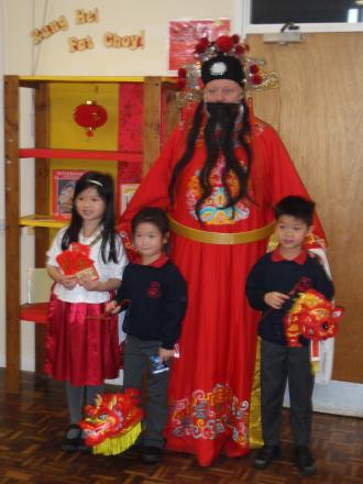 Choi San, the God of Wealth and Prosperity, with sisters Lauren and Jessica Lee and cousin Ethan Mac welcomed the Chinese New Year at Hermitage Primary School last week