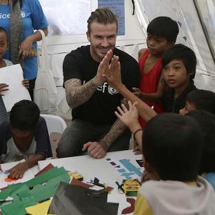 David Beckham meets young typhoon survivors