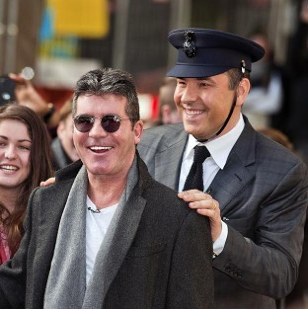 Knutsford Guardian: Britain's Got Talent judges Simon Cowell and David Walliams are caught in a war of gags