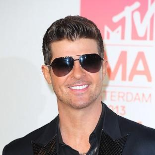 Knutsford Guardian: Robin Thicke says he's hoping to sort things out with his wife