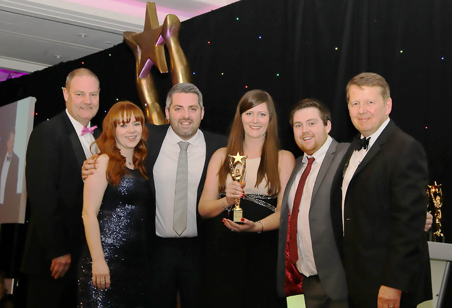 The team from Boxed Red in Knutsford collecting the award from BBC Breakfast host Bill Turnbull, far right.