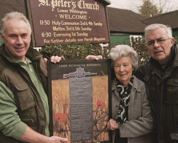 David Clarke and Bernard Tuck present the commemorative artwork to Anne Venables, deputy church warden at St Peter's Church, in Lower Withington
