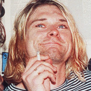 Seattle police have released new photographs discovered during a re-examination of the death of Nirvana's Kurt Cobain
