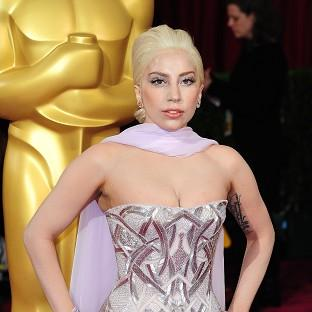 Lady Gaga says her boyfriend wears the trousers