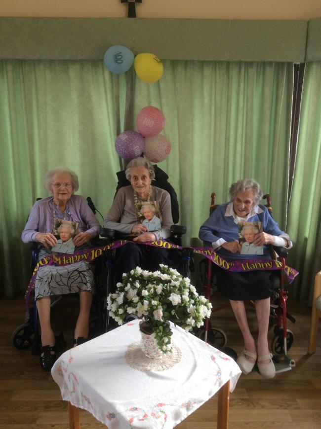 Peggy, 101, Agnes, 100, and Joan, 102, pose for a 'Royal' photo at The Willows Nursing Home in Mobberley