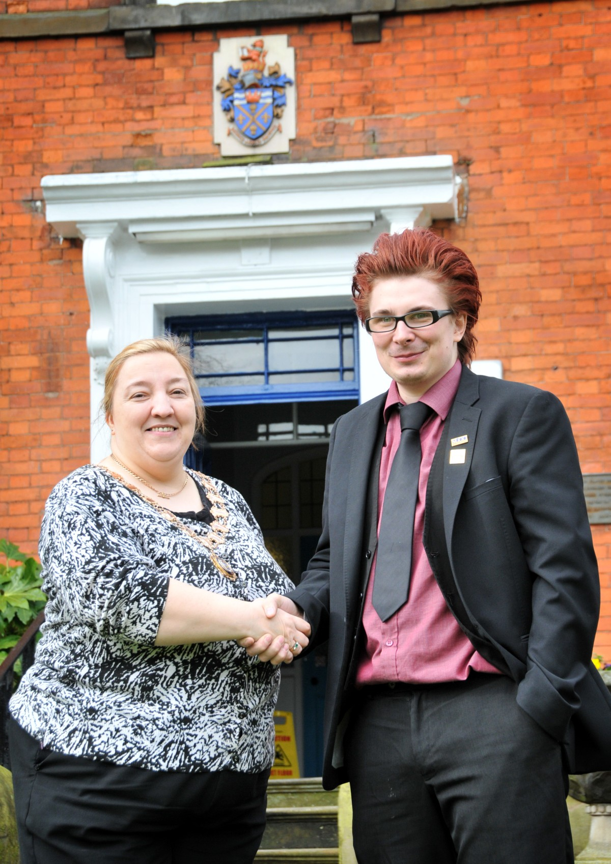 Town Mayor Barbara Coan congratulates Adam Keppel-Garner on his new role as Town Clerk