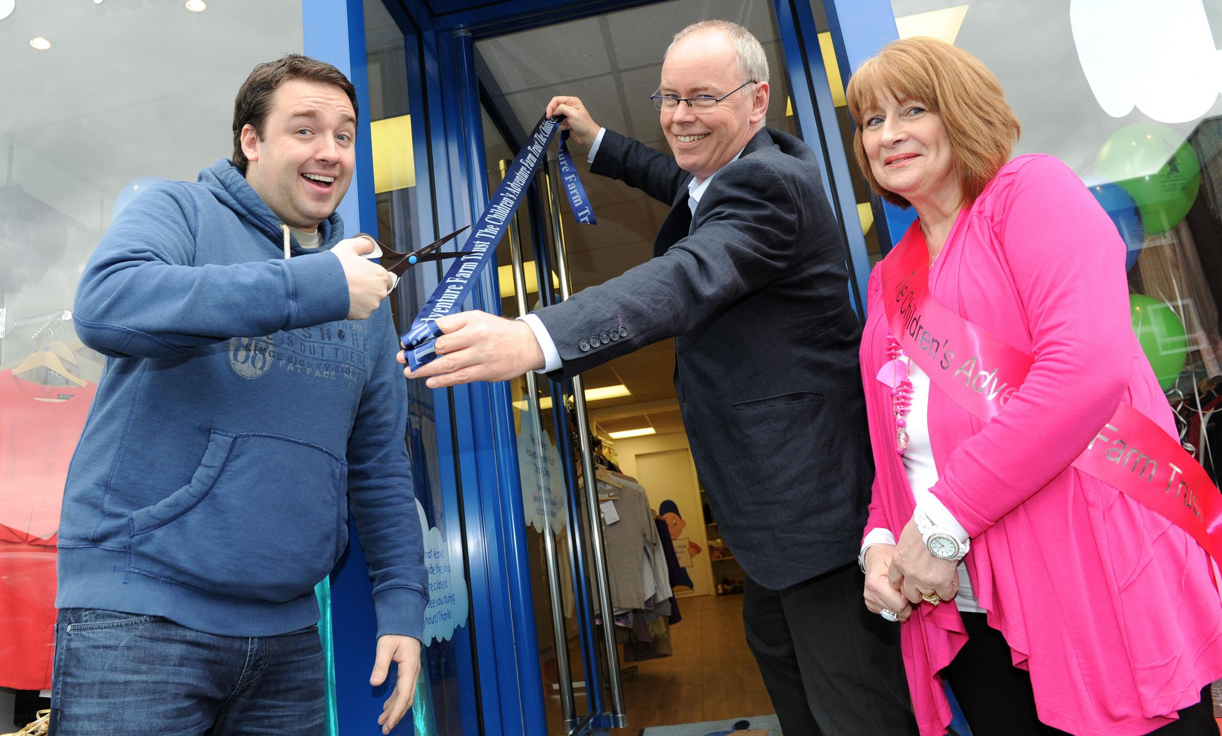 Jason Manford opens the refurbished charity shop in Knutsford. Pictured is Chairman Nick Montague with store manager Sandra Eyes.