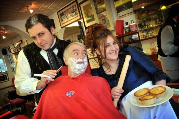 In for a close shave: Owner Dan Belcher a.k.a Sweeney Todd, with father and barbershop co-owner David, and Anna Godden a.k.a Mrs Lovett