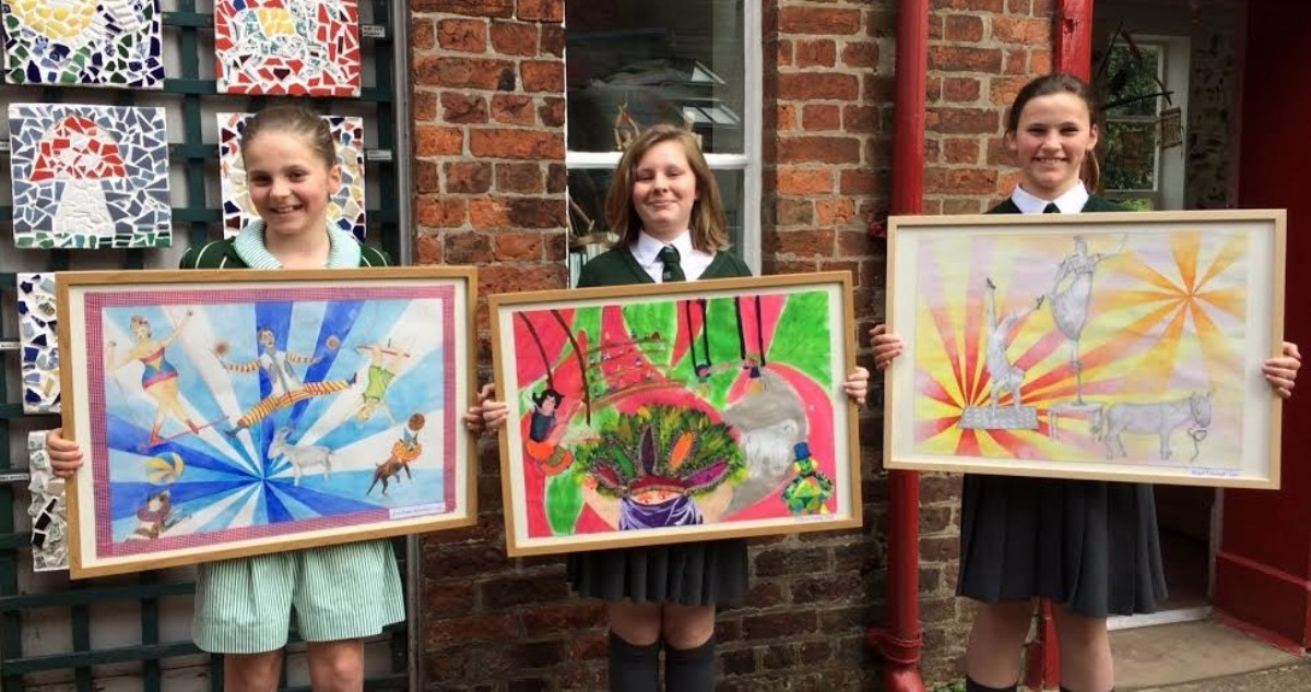 L-r Eve, Erin and Abigail with their circus-themed paintings