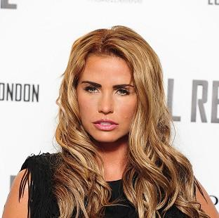 Katie Price has said her third marriage is over