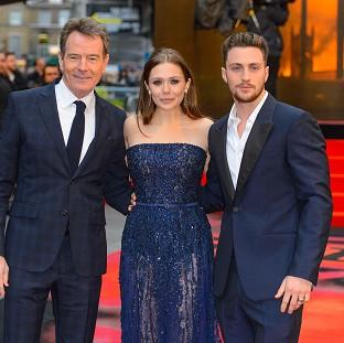 Knutsford Guardian: Bryan Cranston, Elizabeth Olsen and Aaron Taylor-Johnson at the European premiere of Godzilla in London