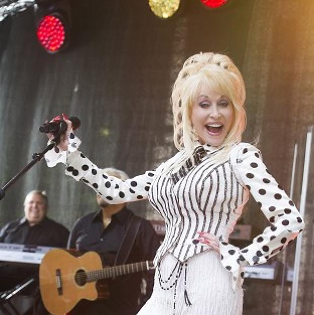 Knutsford Guardian: Dolly Parton has stood up or her goddaughter Miley Cyrus