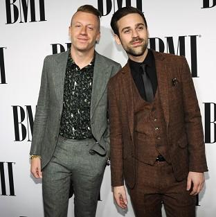 Macklemore (left) apologised for any fuss caused by his costume
