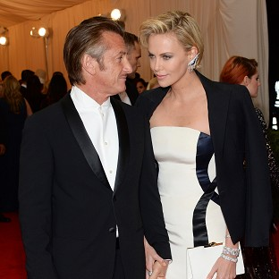Charlize Theron said she and Sean Penn had been friends for years before they started dating