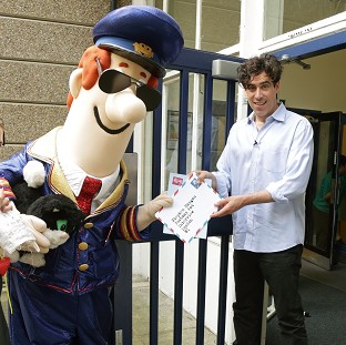 Stephen Mangan, the voice of Postman Pat in the movie, visited a school with the character