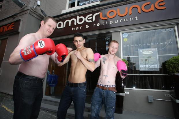Knutsford Guardian: Amber Lounge general manager Chris Langhorn, bartender Stefan Harris, and unit supervisor Mark Hampshire have their gloves at the ready for next month's charity boxing match