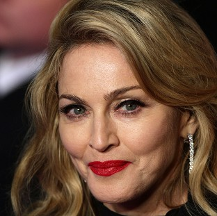 Madonna could take over Kylie Minogue's revolving chair on The Voice, host Emma Willis has suggested