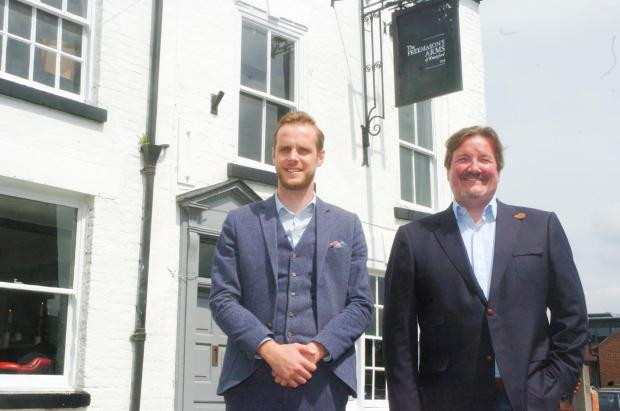 Richard Walker and Matthew Mooney outside their new pub earlier this year.