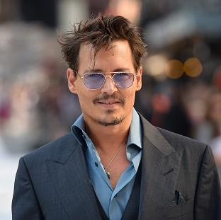 Johnny Depp is in talks to play Houdini in a movie