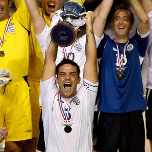Robbie Williams lifted the Unicef Soccer Aid trophy eight years ago
