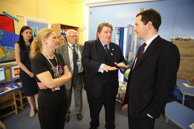 Clr Michael Jones and George Osborne at Peover Superior Primary School on Friday
