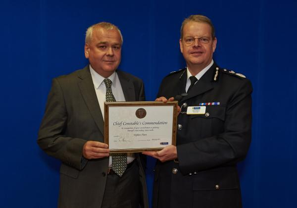 Steve Plant, left, receives his award from Cheshire's Chief Con Simon Byrne