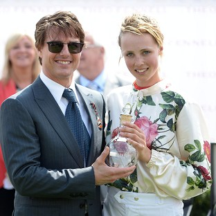 Tom Cruise presented the trophy to supermodel Edie Campbell after winning the Magnolia Cup at Glorious Goodwoo