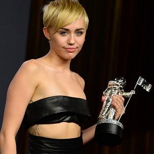 Miley Cyrus poses with the award for video of the year (Jordan Strauss/Invision/AP)