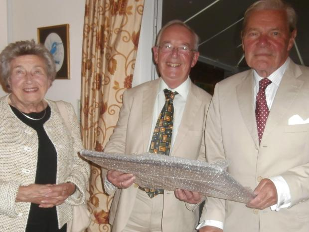 Tony Weir and his wife Margaret received gift of appreciation from the society's chairman Tony Billingham
