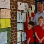 Knutsford Guardian: Daniel Pass, five, Jacob Pass, eight and Peter Godfrey admire the art on display.