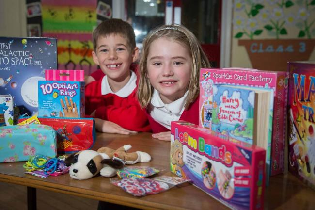 Egerton Primary School students Zack Locke Maisie Farber-Evans get ready for the Christmas Toy Appeal and Operation Christmas Child.  Photo credit: Jonathan Farber